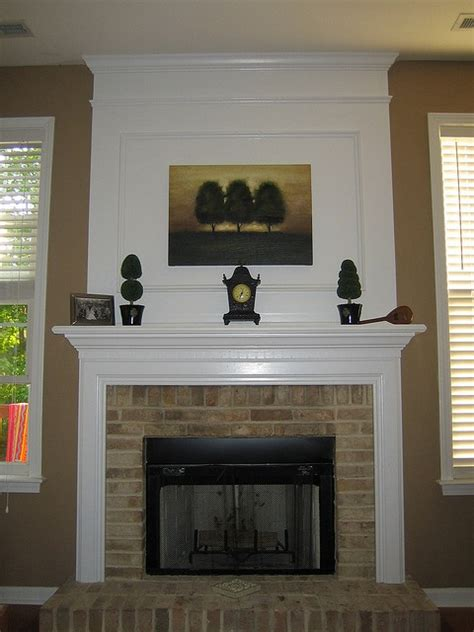 trim around fireplace white moulding with a brick fireplace note the painting