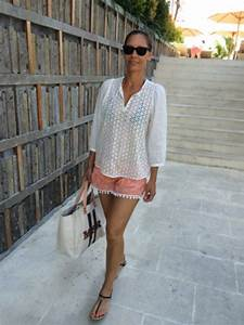 Picture Of With white loose blouse black flat sandals and tote