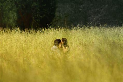 picture field grass boyfriend girlfriend kiss love people romance romantic