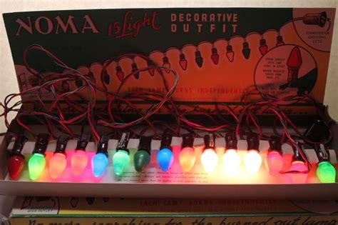 vintage noma lights in original boxes a tree