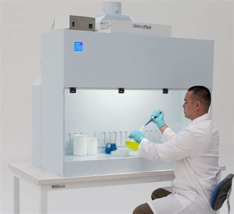 Laboratory Work Benches by Laminar Flow Containment Hood Provides Dual Environment
