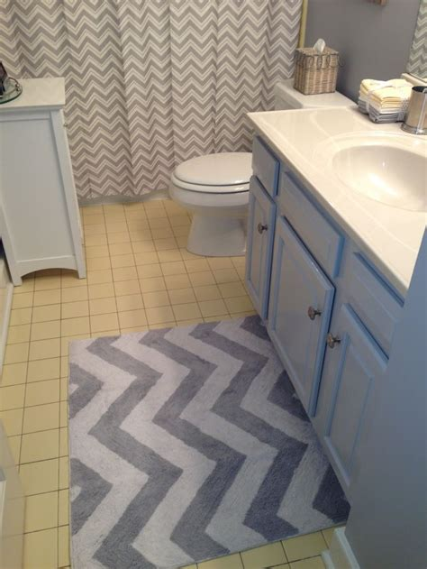 grey chevron rug and shower curtain to update yellow tile bathroom ideas for yellow and grey