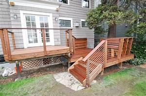 An Ipe Hardwood deck with cable rail system We also