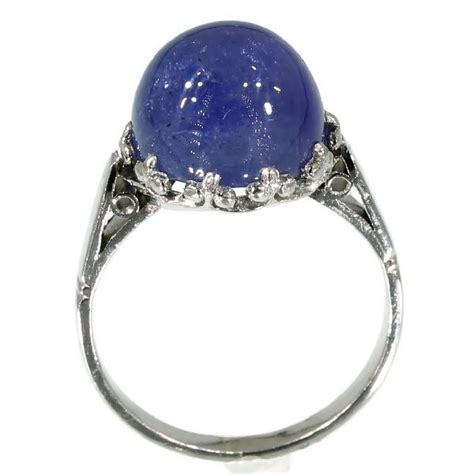 Estate Platinum Engagement Ring With Cabochon Tanzanite 10. Fire Opal Rings. Engaged Engagement Rings. Iris Rings. Fisherman Rings. 1.1 Carat Engagement Rings. 2.4 Carat Engagement Rings. Lotr Rings. Marquee Wedding Wedding Rings