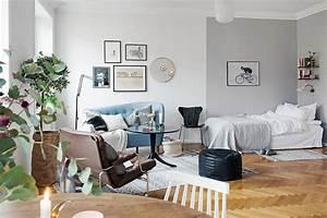 Stylish swedish studio apartment lives large for Stylish studio apartment living room ideas