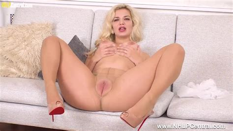 Busty Blonde Bad Dolly Strips Teases In Nude Crotchless