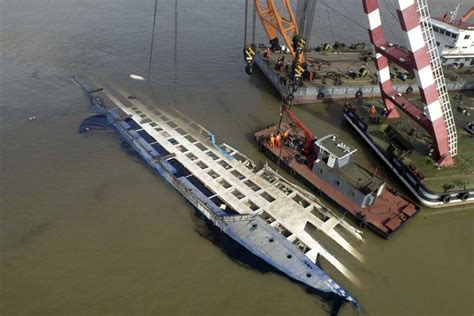 Legend Boats Ont by Rescuers Work On Righting The Capsized Cruise Ship Eastern