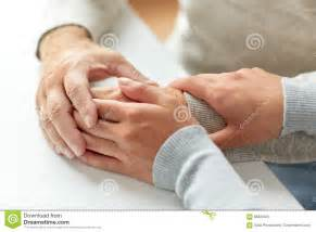Close Up Of Old Man And Young Woman Holding Hands Stock ...