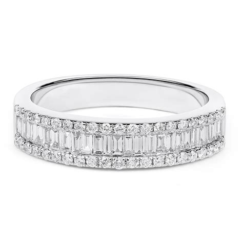 round and baguette diamond wedding ring in 18k white gold