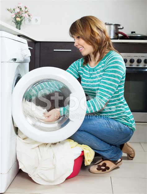 doing laundry by happy woman doing laundry with washing machine stock photos freeimages com
