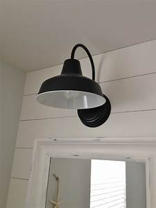 Barn wall sconce lends farmhouse look to powder room for Barn style bathroom lighting
