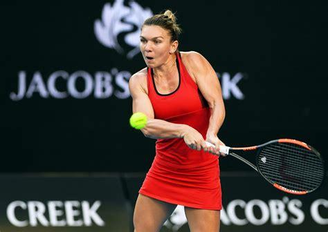 Australian Open final: Caroline Wozniacki finally wins a Grand Slam after beating Simona Halep in Melboune thriller