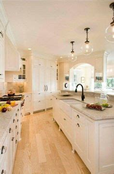 kitchen with cabinets galley kitchen wood flooring white shaker beadboard 3493