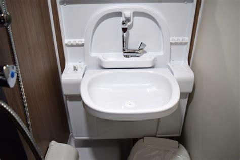 feature   spotlight  cirrus camper fold  bathroom sink truck camper adventure