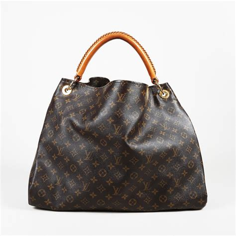 lyst louis vuitton artsy gm monogram coated canvas top handle bag  brown