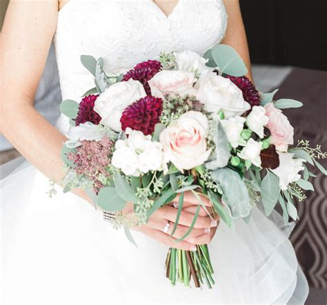 blush and burgundy bridal bouquet with roses dahlias and