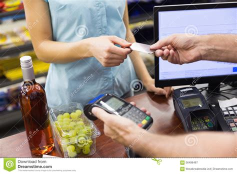We did not find results for: Woman At Cash Register Paying With Credit Card Stock Image ...