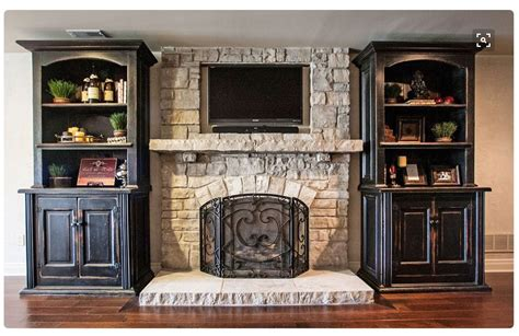 stone fireplace  tv  wooden shelves   sides