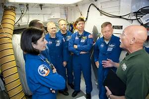 Discovery crew reviews emergency procedures, straps in for ...