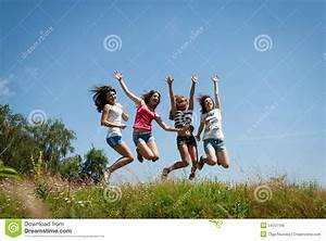 Four Beautiful Happy Teen Girls Friends Jumping Stock ...