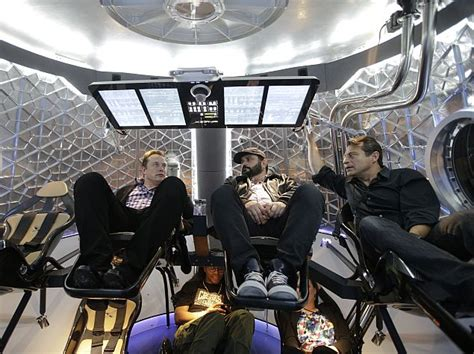 spacex unveils dragon  spacecraft  ferry astronauts