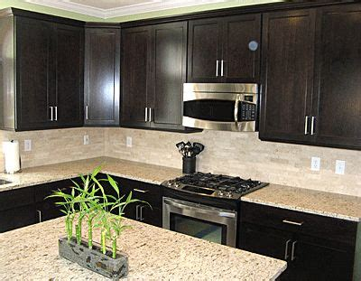 espresso kitchen cabinets with backsplash backsplash and counters expresso cabinets sleek but