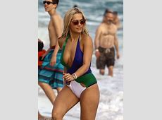 Rita Ora shows off her ample assets in lowcut swimsuit in