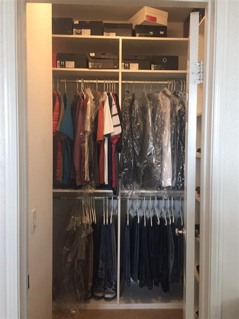 husbands small reach in closet that can now hold all his