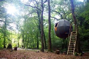 christmas trees tree tents suspended from wires in cornish forest are