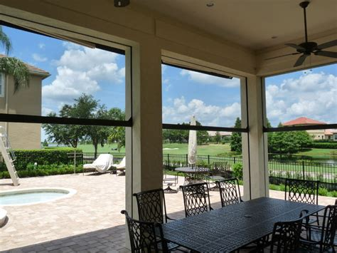 motorized retractable screens traditional patio