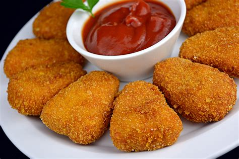 A) a lump of fried chicken in which the entire kfc franchise is based around. Nuggets de Pollo - recetas