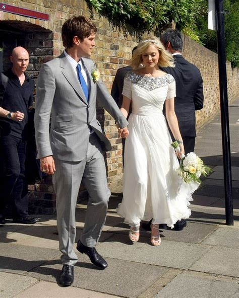 Fearnetton Pictured In Stunning Gown As She Ties The