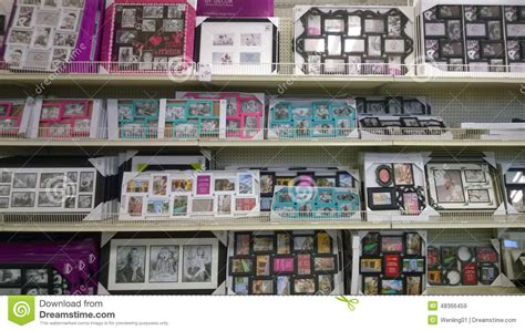 picture frames on shelves selling editorial stock