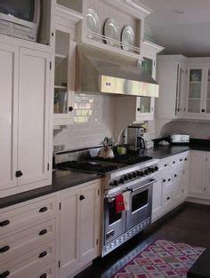 kitchen cabinets with glass kitchen range mantle traditional kitchen wolf vent 6470