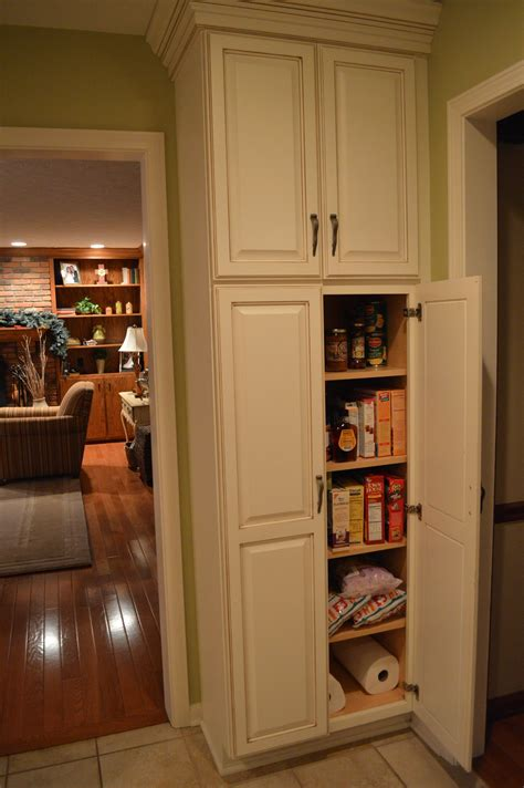 white wooden tall narrow pantry cabinet  maple wood