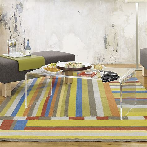Clear Acrylic Coffee Table On Colorful Carpet Tiles And