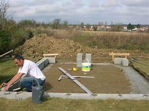 Construction de mon abri de jardin Pose de la première pierre