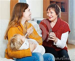 Woman With Mature Mother Giving Syrup To Unwell Baby Stock ...