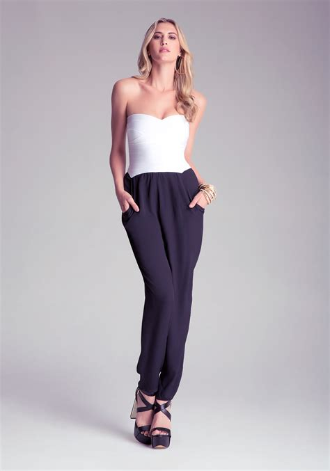 flared jumpsuit bebe flared jumpsuit in white lyst