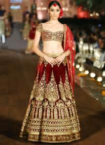 lengha choli for engagement heavy maroon velvet bridal lehenga with golden aari handwork
