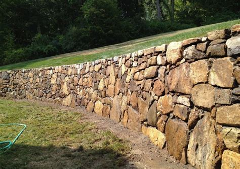 Instead of living with this drab look, you can spruce up the cinder surface with a decorative stone that fits with your design or theme, such as slate, sandstone or smooth river rock. Southbury, CT - Stone or Block Walls, Retaining Walls ...