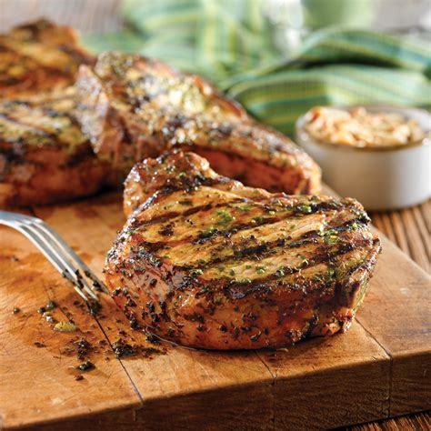 Lay the chops in the skillet about 1/4 inch apart, if using bone in chops place the bones inwards to center of skillet. Grilled Pork Chops with Basil-Garlic Rub - Pork Recipes ...