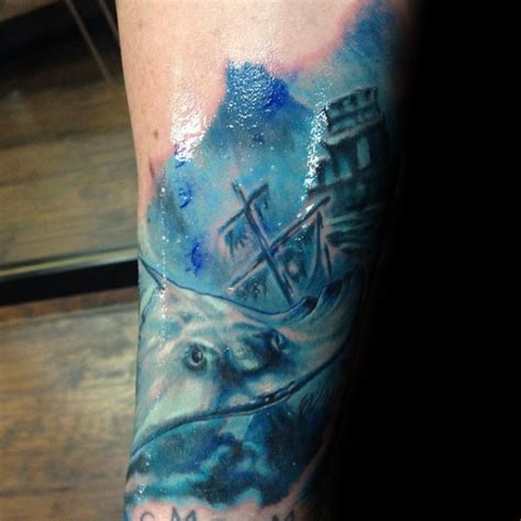 homemade watercolor style painted arm tattoo  swimming