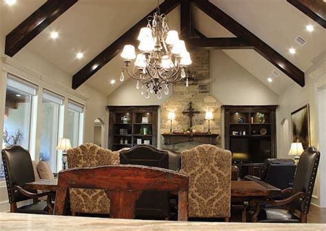 open concept living space featuring vaulted ceiling  wood beams  floor  ceiling