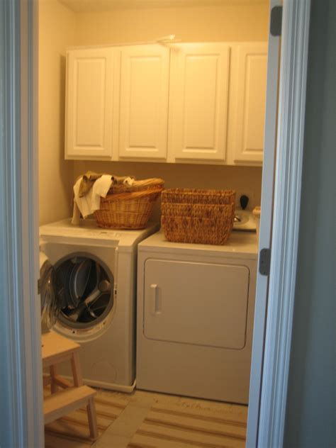 Kitchen Wall Shelving Ideas - old very small laundry room makeover design with white wooden cabinet rattan basket dirty