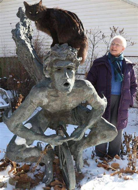 merle hay malls naked angel  tricycle sculpture landed