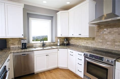 traditional white  stone backsplash kitchen traditional kitchen   ub kitchens