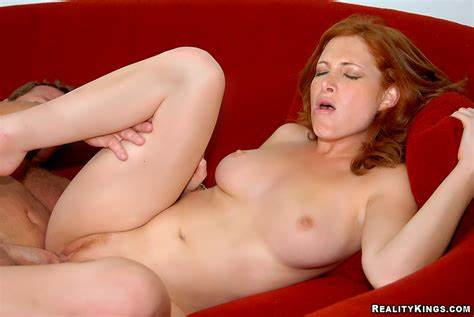 Comely Ginger Pleasures Herself For Your Enjoyment