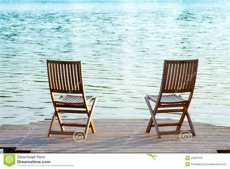 two chairs on dock stock photo image 43901876