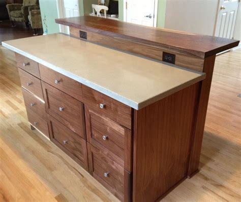 kitchen islands with bar custom kitchen island with slab bar top by saw tooth